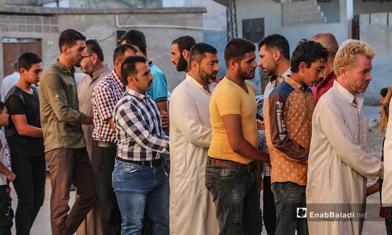 Worshipers exchange greetings after the Eid al-Adha prayer in Dabiq town in northern Aleppo countryside – 31 July 2020 (Enab Baladi / Abdul Salam Majan)