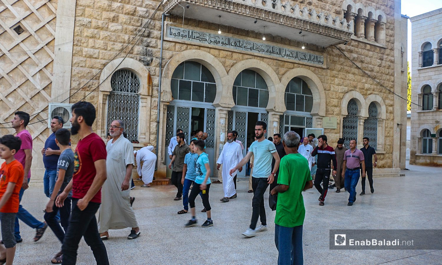 People exiting  a mosque after the end of the Eid al-Adha prayer in Dabiq town in northern Aleppo countryside – 31 July 2020 (Enab Baladi / Abdul Salam Majan)