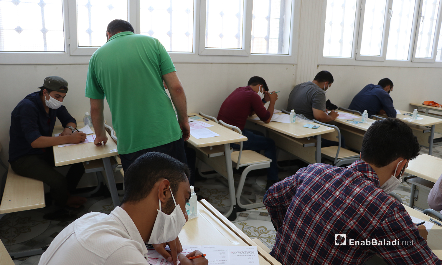 Students undergoing the final exams of the high school certificate amid the coronavirus (COVID-19) protective measures in al-Bab city of northern Aleppo countryside – 12 July 2020 (Enab Baladi / Asim Melhem)