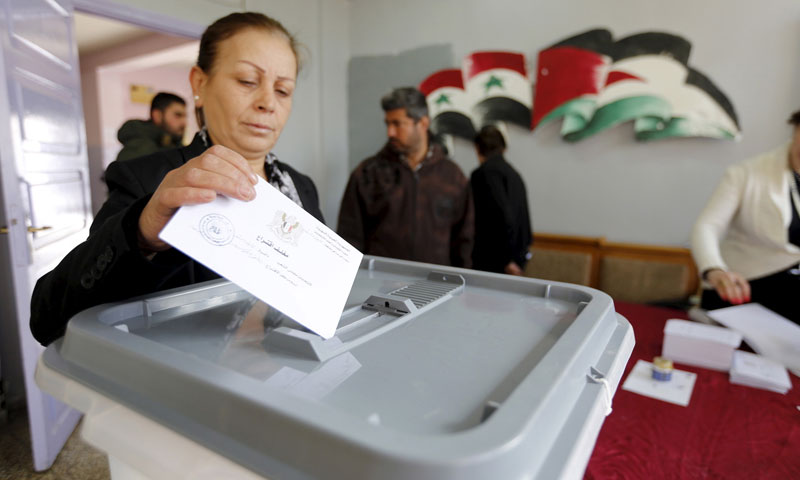 A woman voting in the recent People's Council elections in the regime-held areas (Russia Today)