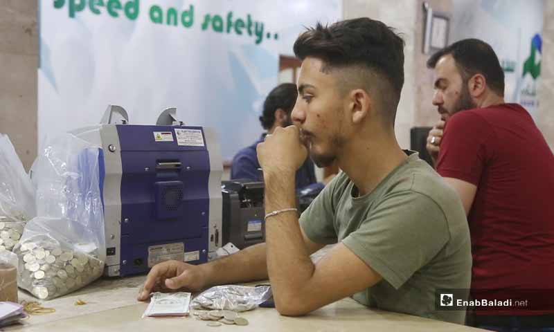 Syrian citizens replacing the Syrian pound with the Turkish lira in Idlib city - June 2020 (Enab Baladi / Yousef Ghuraibi)