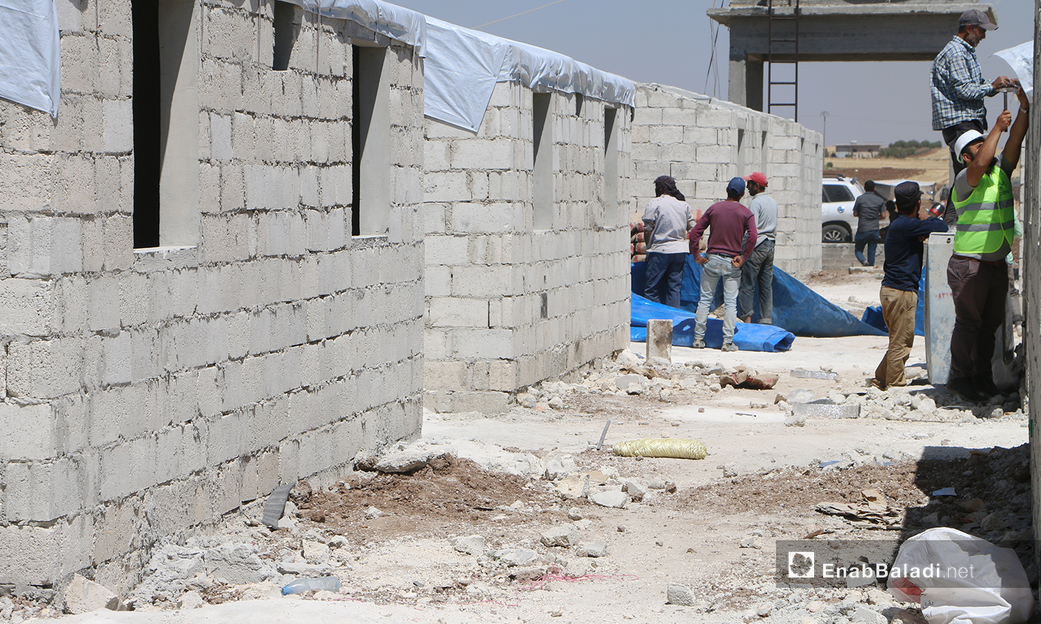 The project of establishing concrete housing units to replace the makeshift tents in Bahorta village of northern Aleppo countryside – 26 June 2020 (Enab Baladi / Abdul Salam Majan)