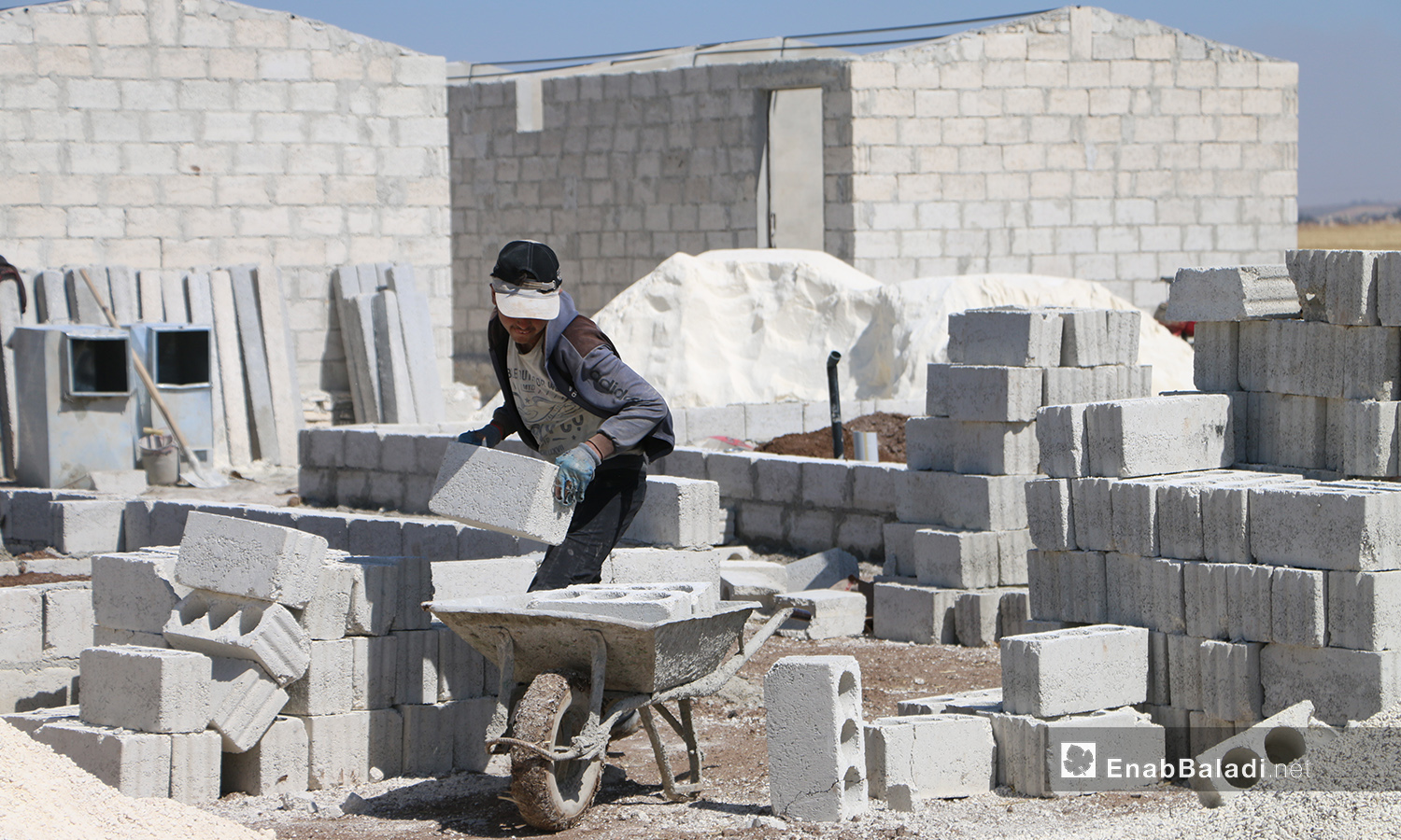 A construction worker of the concrete housing units