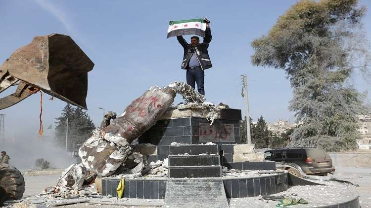 """The destruction of the statue of """"Kawa the Blacksmith"""" in Afrin city - 2018 (Daraj)"""