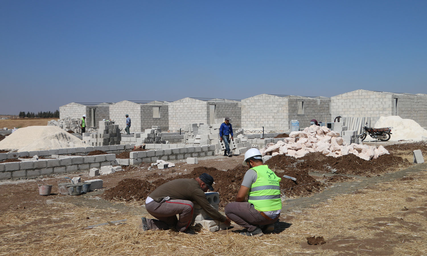 The construction work of housing units to replace the makeshift tents by humanitarian organizations and bodies in northern Syria - 25 June 2020 (the local council Facebook account)