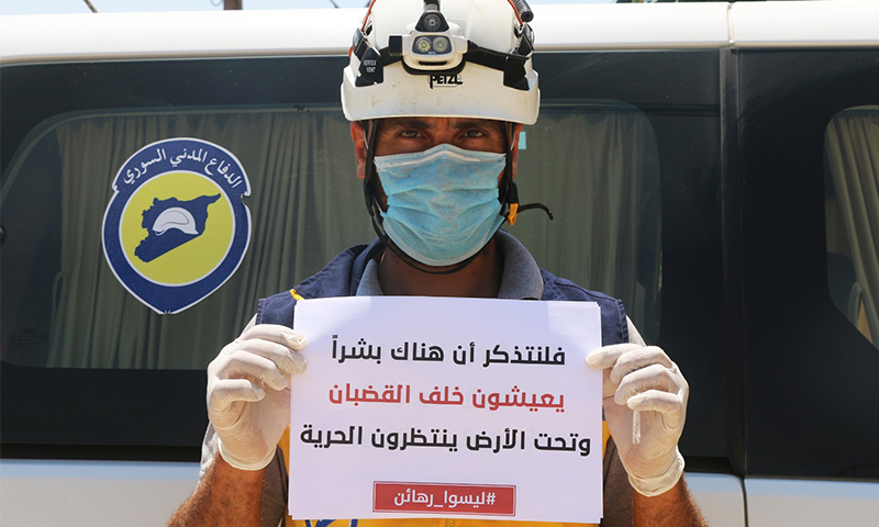 """A Syrian Civil Defence volunteer participating in the """"They Are not hostages"""" campaign to show solidarity with the detainees in the regime's prisons (Syrian Civil Defence)"""