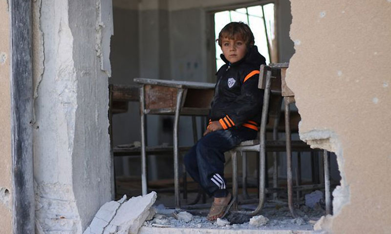 A child sitting in a destroyed school - 2016 (UNICEF)