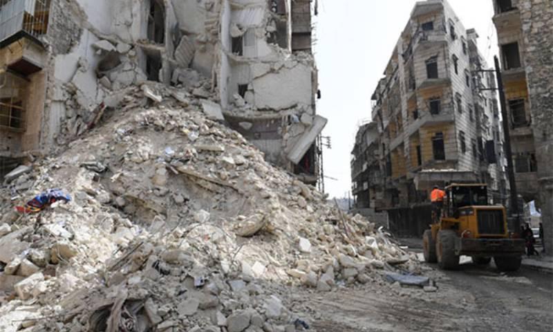 A rubble removal machinery in Homs city - 25 July 2020 (Al-Watan Online)