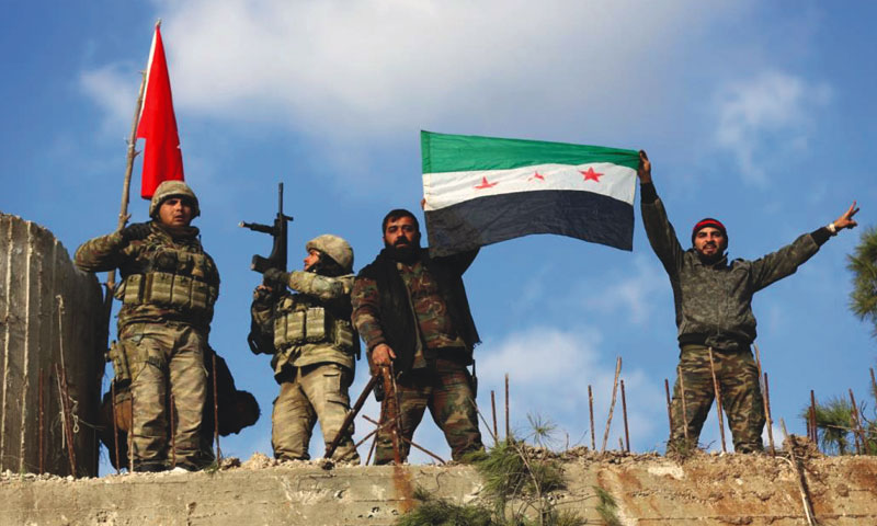 Turkish soldiers and Syrian opposition fighters after controlling Afrin (Reuters)