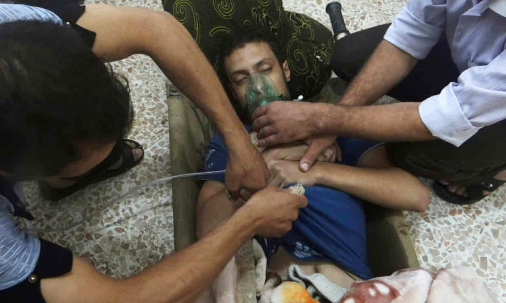 A man receiving treatment after a chemical attack in Eastern Ghouta - August 2013 (Reuters)