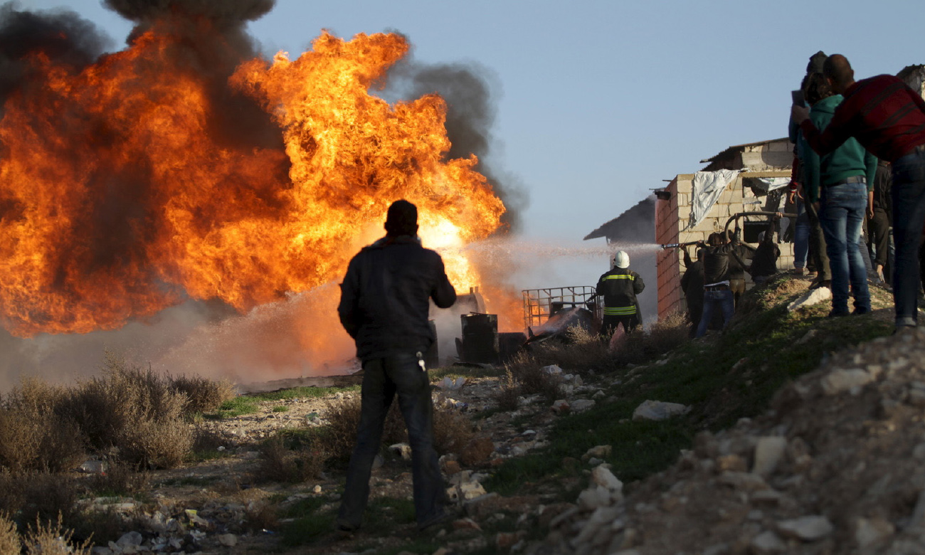 Syria's opposition Civil Defense volunteers extinguishing a fire at a rudimentary oil refinery in Ma'arrat al-Nu'man, Idlib – 10 March 2020 (Reuters)