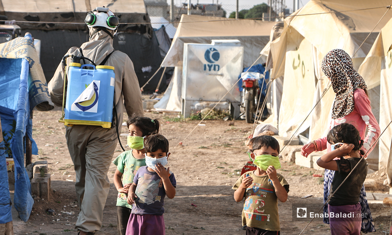 Syria's Civil Defense volunteers are taking preventive measures against coronavirus in the displacement camp of Dabiq, north of Aleppo - 12 July 2020 (Enab Baladi- Abdul Salam Mujaan)