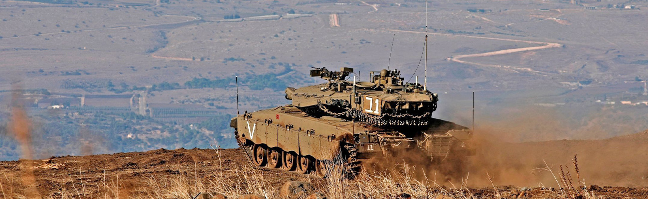 An Israeli armored vehicle in the occupied Golan Heights near the Syrian borders hours after firing four missiles - November 19, 2019 (AFP)