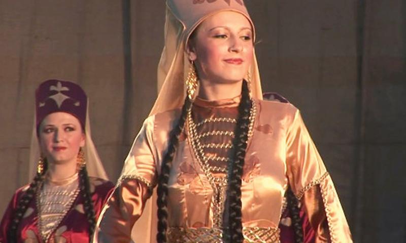 A Circassian woman wearing the traditional decorated Circassian dress - 2019 (Al-Jazeera)
