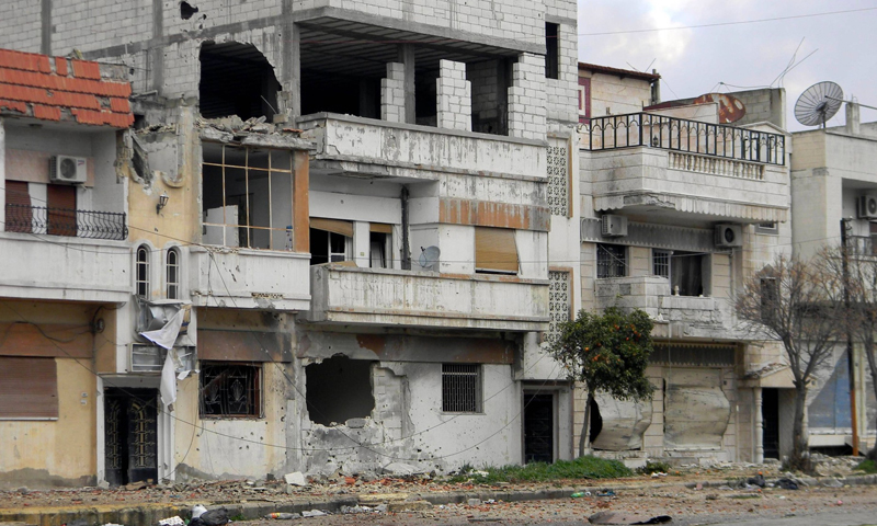 Destroyed houses by the Syrian regime's bombing on the protest center in Homs city, central Syria - 11 February 2012 (AFP)