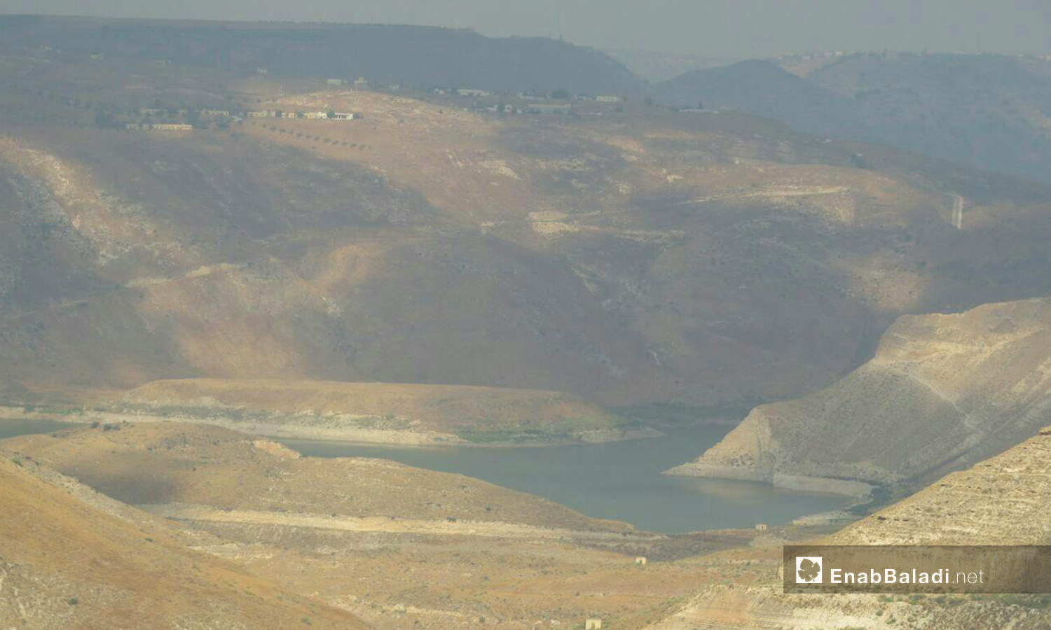 An image of the Yarmouk Valley taken from Zizoun town in western Daraa countryside, in which the al-Wehda Dam appears – 07 August 2020 (Enab Baladi / Halim Mohammad)