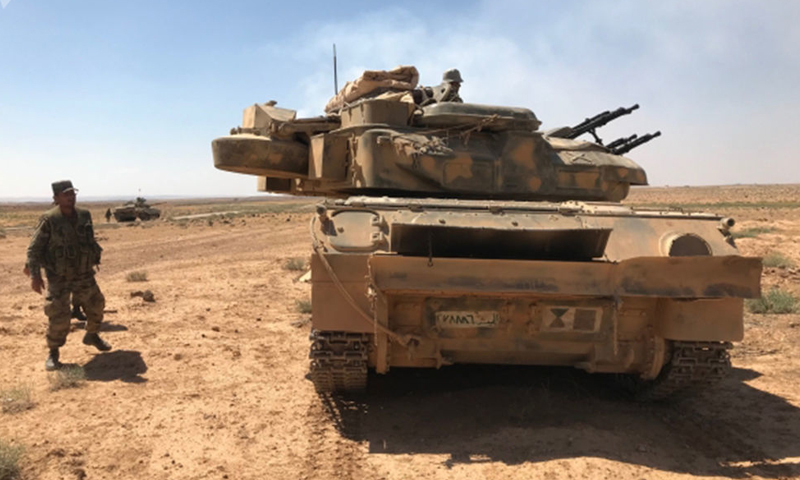 A member of the regime's army next to a Shilka vehicle in Daraa governorate - July 5, 2018 (Sputnik)