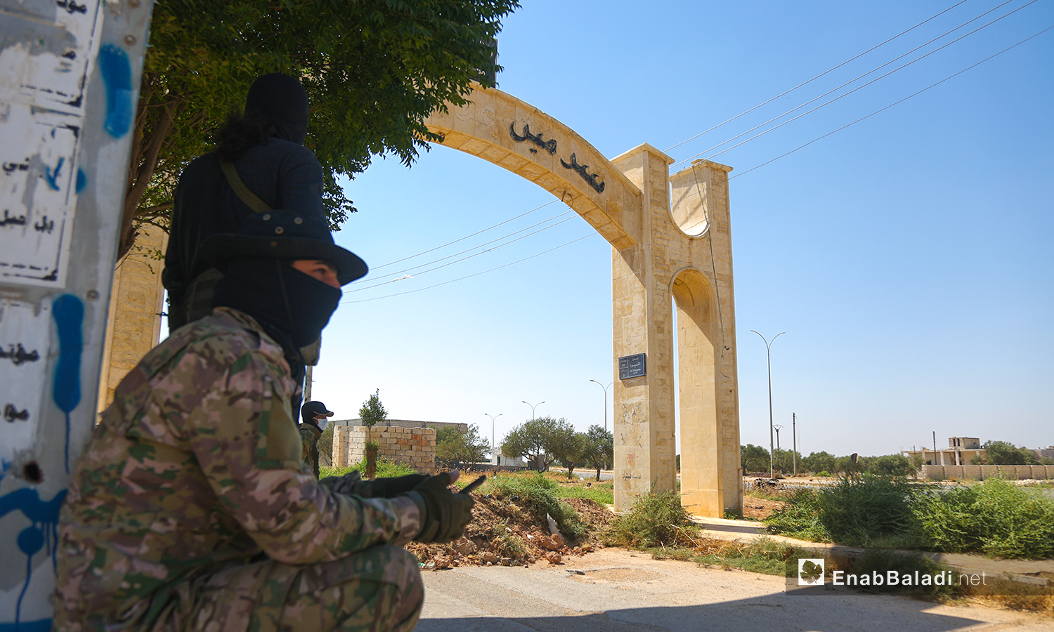 """The security forces of """" the Salvation Government"""" block the roads to the city of Sarmin in rural Idlib as part of preventive measures to curb the spread of the coronavirus- 25 July 2020 (Enab Baladi- Youssef Ghribi)"""
