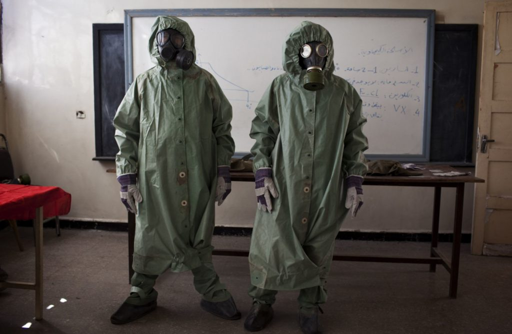 Volunteers wearing chemical protective clothing in a classroom in Aleppo – 15 September 2013 (AFP)