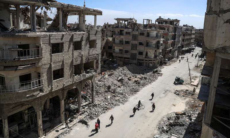 Destroyed buildings in the Eastern Ghouta of Damascus (EPA)