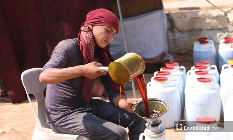 Grape molasses making process in Aleppo countryside - 18 September 2020 (Enab Baladi)