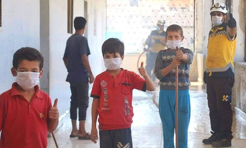 Children in the town of Ihsim in the southern countryside of Idlib are engaged in cleaning the town's school with the Syrian Civil Defence - 25 September 2020 (Syrian Civil Defence)