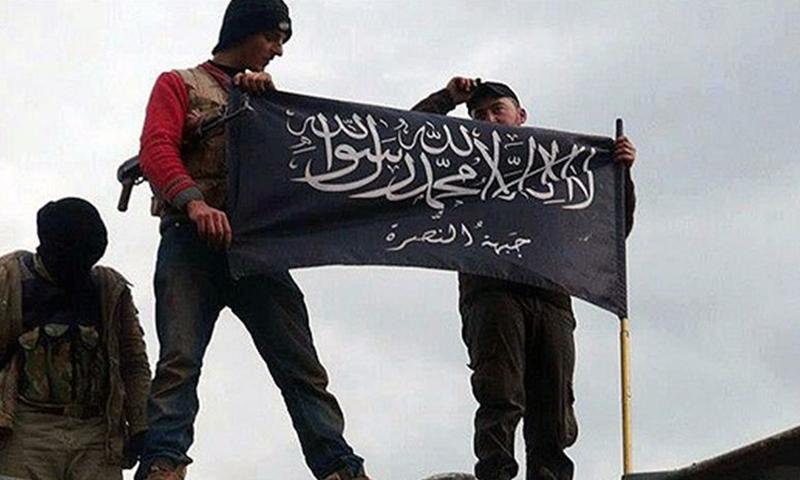 """""""Jihadists"""" lifting the al-Nusra Front's flag (AP)"""