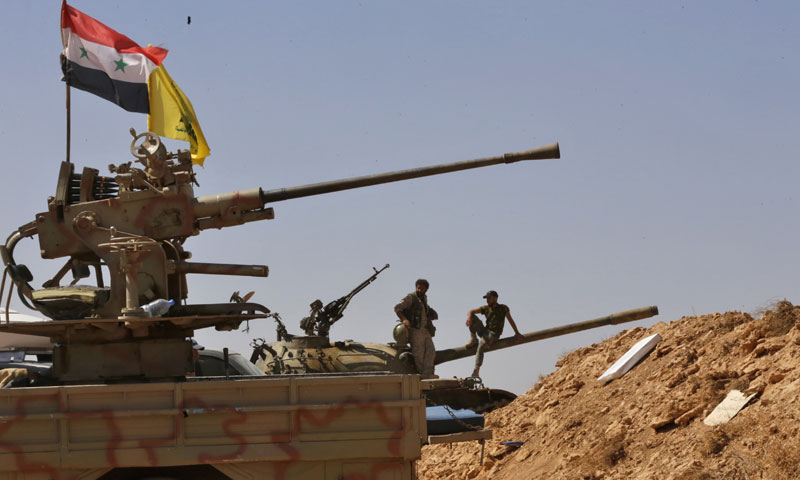 Members of the Lebanese Hezbollah militia in the western al-Qalamoun area - (AFP)
