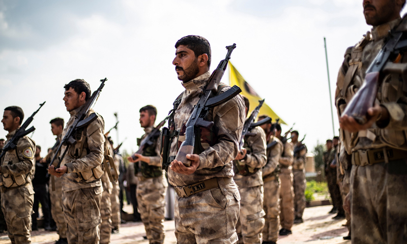 """Members of the """"Syrian Democratic Forces (SDF)"""" participate in the funeral memorial of one of the SDF fighters in Deir Ezzor province, northeastern Syria - 10 April 2019 (AFP)"""