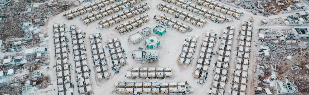 An aerial view of a camp for internally displaced people in the form of a five-pointed network near the town of Kafr Lusin in north-western Syria - 29 September 2020 (AFP / Omar Haj Kaddour)