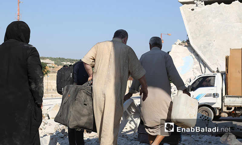 Syrian internally displaced persons moving the furniture of their destroyed houses in southern Idlib countryside during the relative calmness in the area - 06 September 2019 (Enab Baladi)