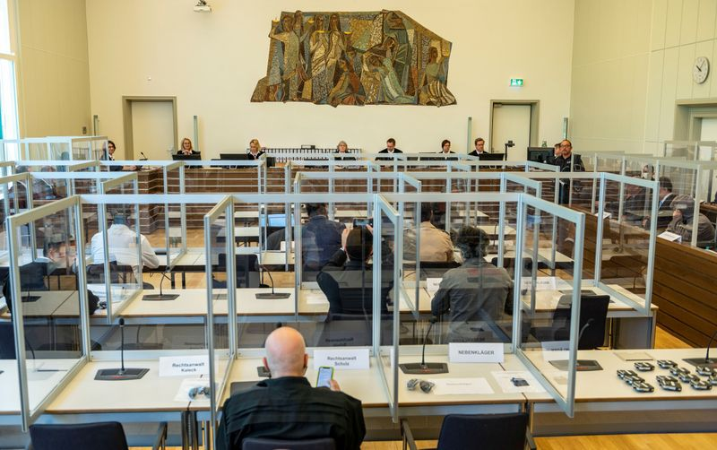 A German court session in Koblenz to prosecute the two Syrian officers Anwar Raslan and Eyad Al-Gharib for committing a crime against humanity - 23April 2020 (AFP)