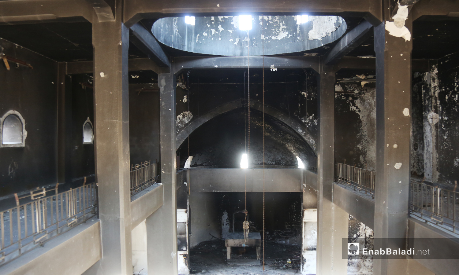 """The interior hall of """"Mar Georges"""" Church was burned as a result of bombardment and is still not restored yet – July 2020 (Enab Baladi)"""