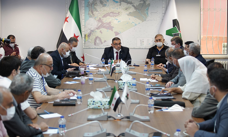 Anas Abdah, the former president of the Syrian National Coalition in a meeting with coalition members (The official website of the Syrian National Coalition)