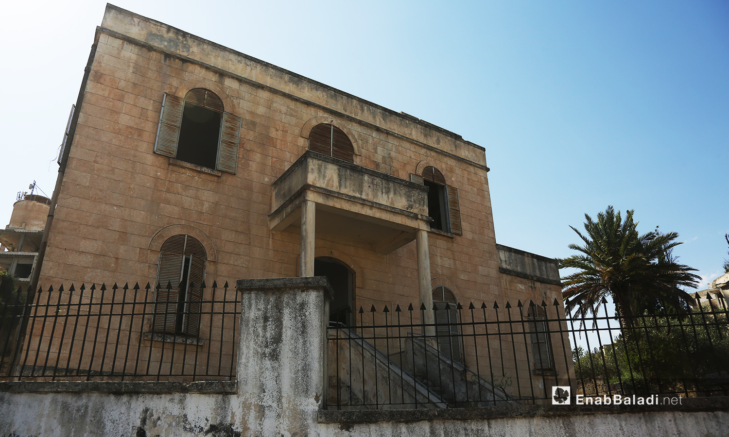 """""""Mar Georges"""" Church for the Greek Orthodox in Jisr al-Shughur city in the Southern Idlib countryside still has its structure despite being bombed during the war years in Syria – July 2020 (Enab Baladi)"""