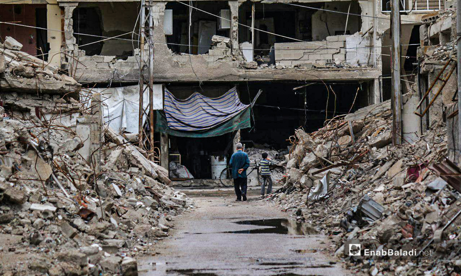 A destroyed street in Zamalka city - 29 December 2018 (Enab Baladi / Abdulmeen Homs)