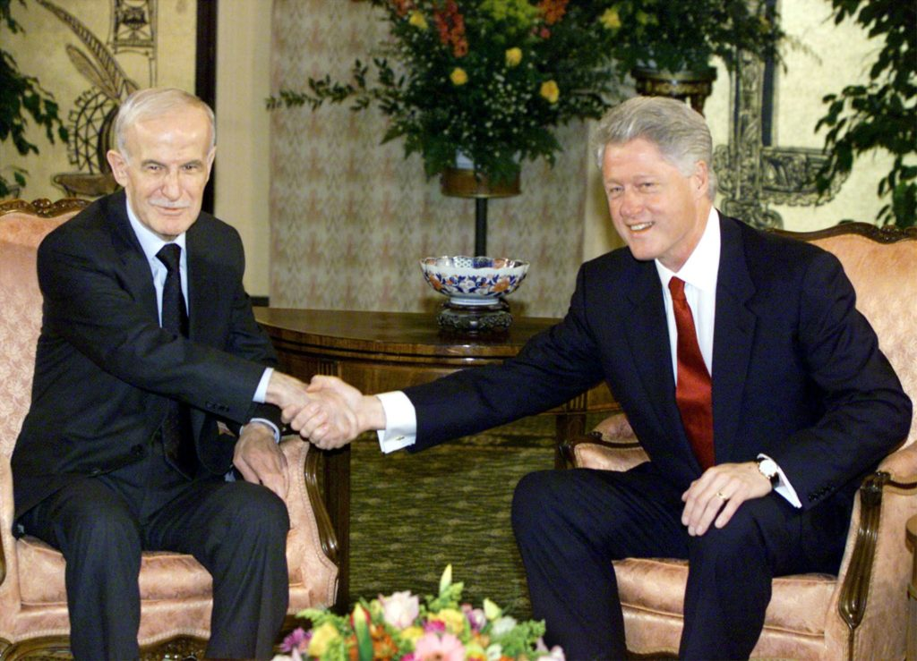 Hafez al-Assad and former US President Bill Clinton in Geneva, Switzerland, for peace talks between Syria and Israel, 1999 (Reuters)