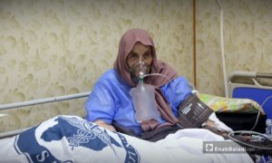 An elderly woman infected with COVID-19 – 18 October 2020 (Enab Baladi-Yousef Ghraibi)