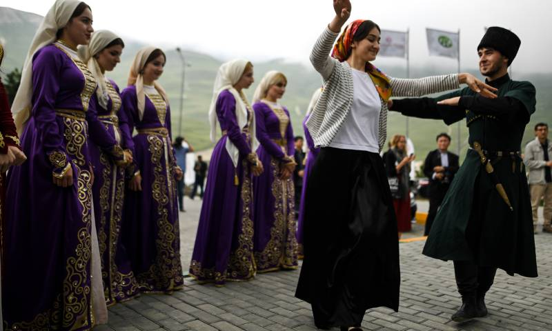 Chechens dancing their traditional dance (AFP)