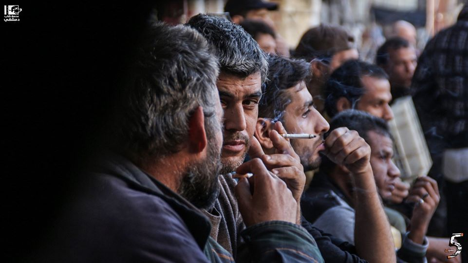 A group of Syrian men smoking cigarettes in southern Damascus - 2 February 2018 (Lens of Young Damascene)