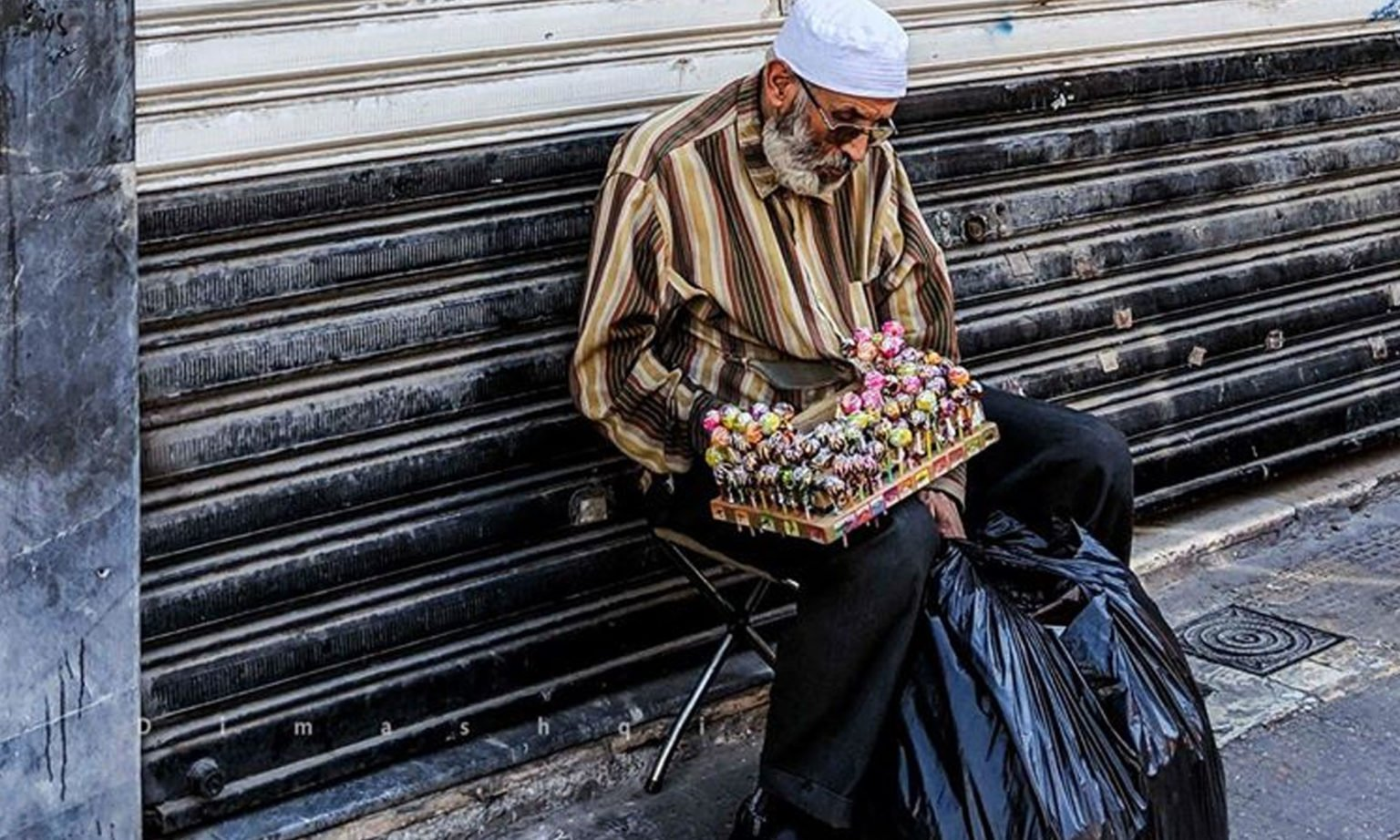 An old man selling shoes in a Damascus alley — 17 November 2019 (Lens of Young Damascene)