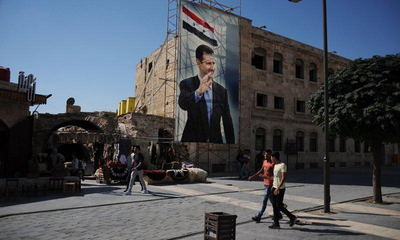 A banner of Syrian President Bashar al-Assad in Aleppo, Syria - 2020 (AP)