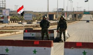 A checkpoint of the Syrian regime forces at the entrance to Damascus city (Reuters)