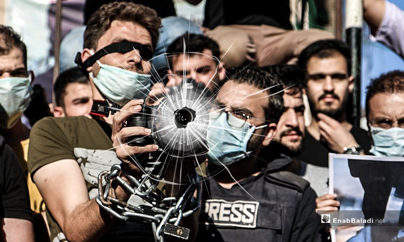 A protest stand against the repeated attacks by military forces on journalists and photographers in northern Syria - 10 June 2020 (edited by Enab Baladi)