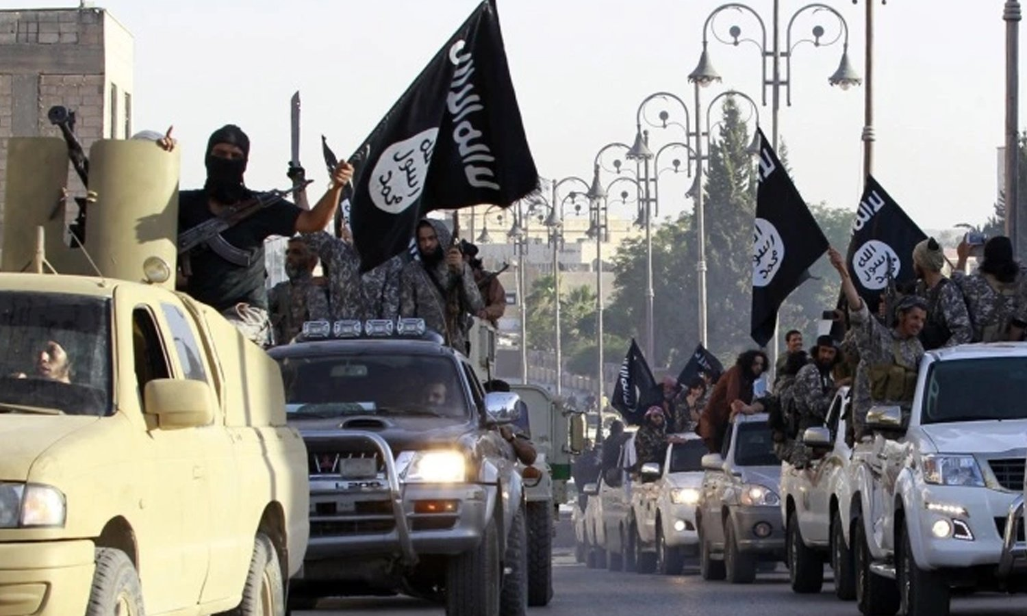 A convoy of the Islamic State (IS) parading in Raqqa streets—mid-2014 (Reuters)