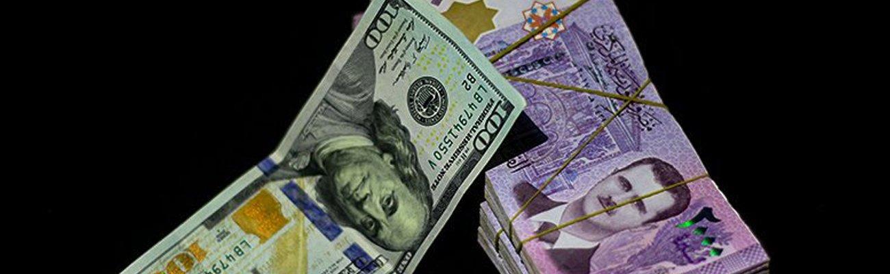Syrian 2000-pound bill and U.S. 100-dollar bill— designed by Enab Baladi