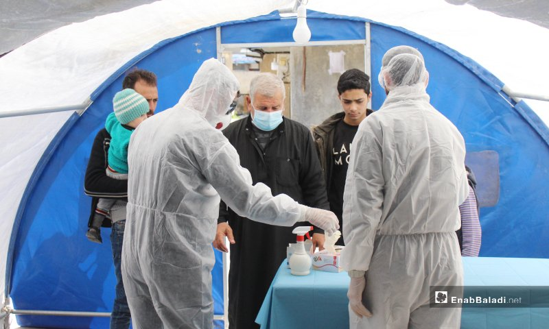 Patients instructed on COVID-19 precautionary measures at the newly established COVID-19 department in Kafar Takharim Hospital in Idlib—27 March 2020 (Enab Baladi)