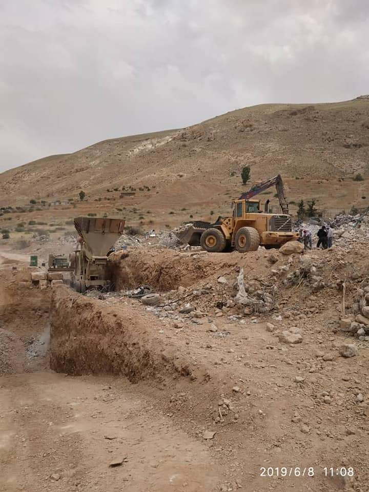 The Syrian regime's machinery demolishing story buildings on the bank of the Barada River in Ain al-Fijeh in Rif Dimashq governorate - 7 June 2019 (the General Housing Establishment)