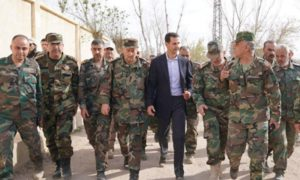 The head of the Syrian regime, Bashar al-Assad, visiting the regime's forces in the countryside of Damascus - 18 March 2018 (SANA)