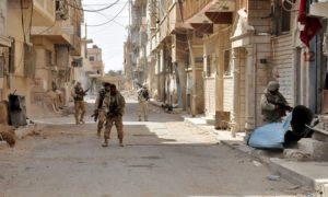 Regime forces in Homs — March 2018 (Reuters)